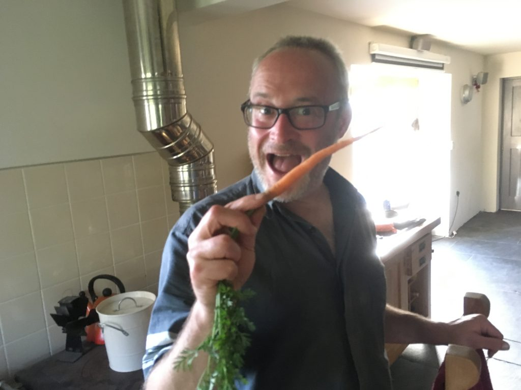 Julian looks evil/delighted/anticipatory when faced with the first carrot of the year